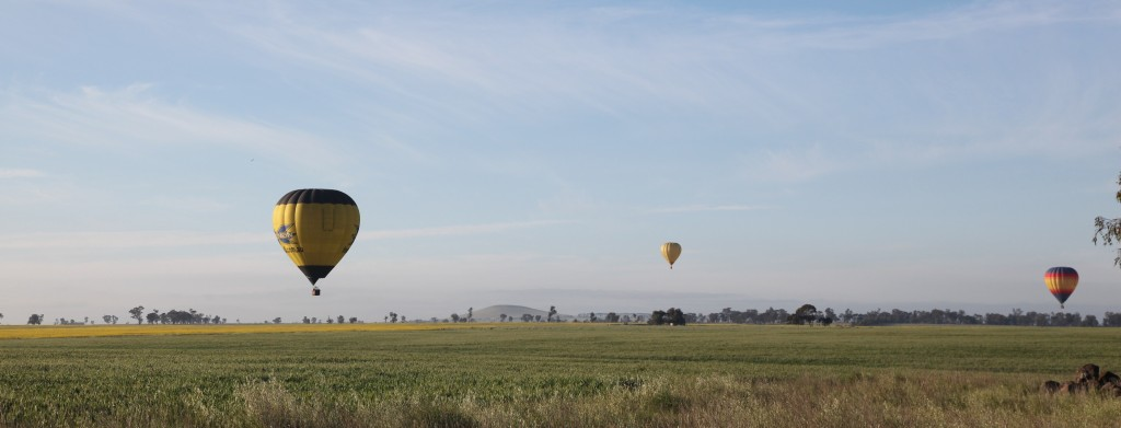 Three balloons flying together over Maryborough